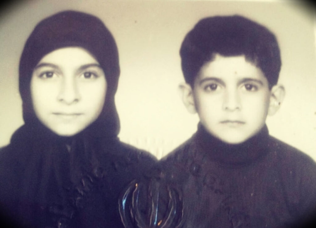 Here is a photo of  a young Patrick alongside his sister Polet wearing hijab