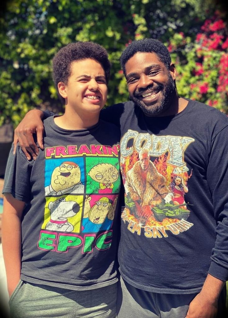 Ron Funches with his son