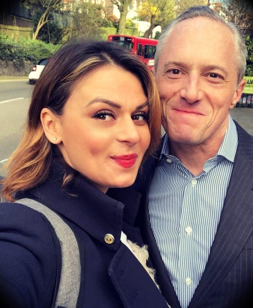 Brian rose with his wife Mariana Aleksieva