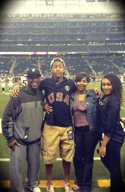 Eric Thomas with his wife and children