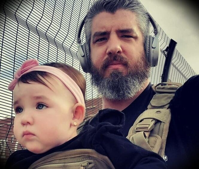 Luke Thomas with his daughter