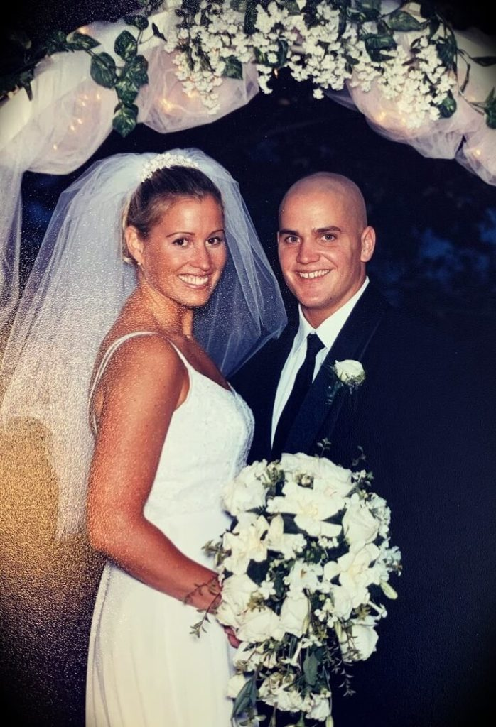 Mark Bell with his wife Andee Greves Bell in their wedding