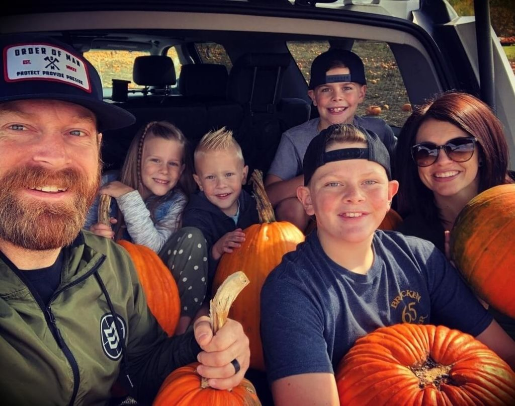 Ryan Michler with his wife and children
