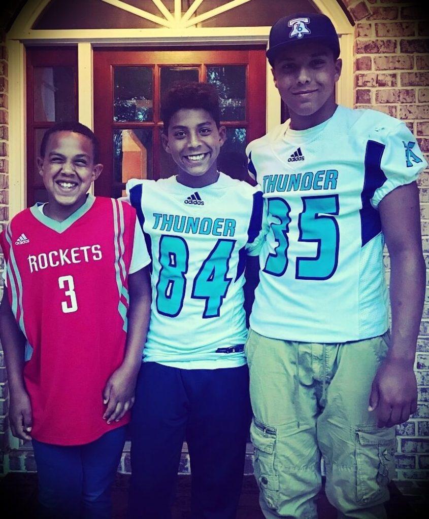 Chris Hogan's three sons