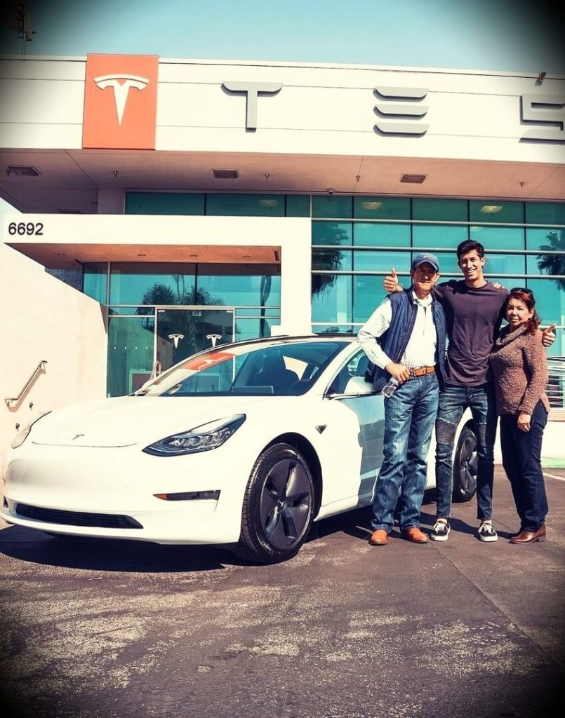Ricky Gutierrez with his father, gifting him a Tesla