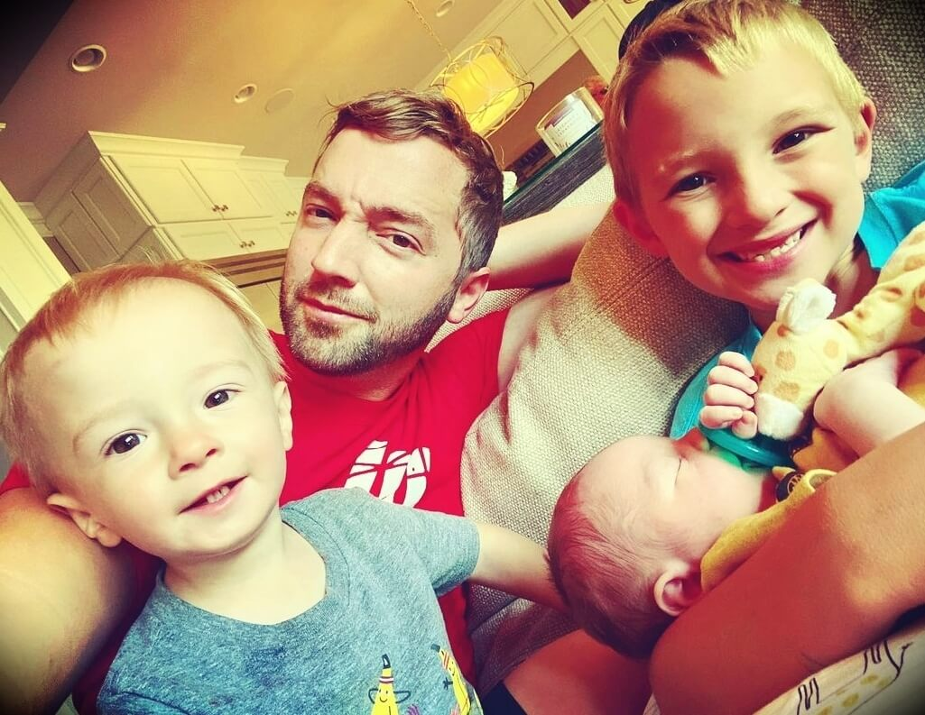 Andy Schrock with his three sons