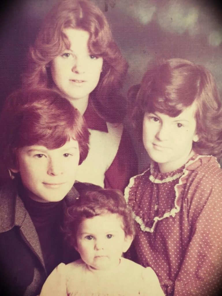A young Mark Tilbury with his three sisters