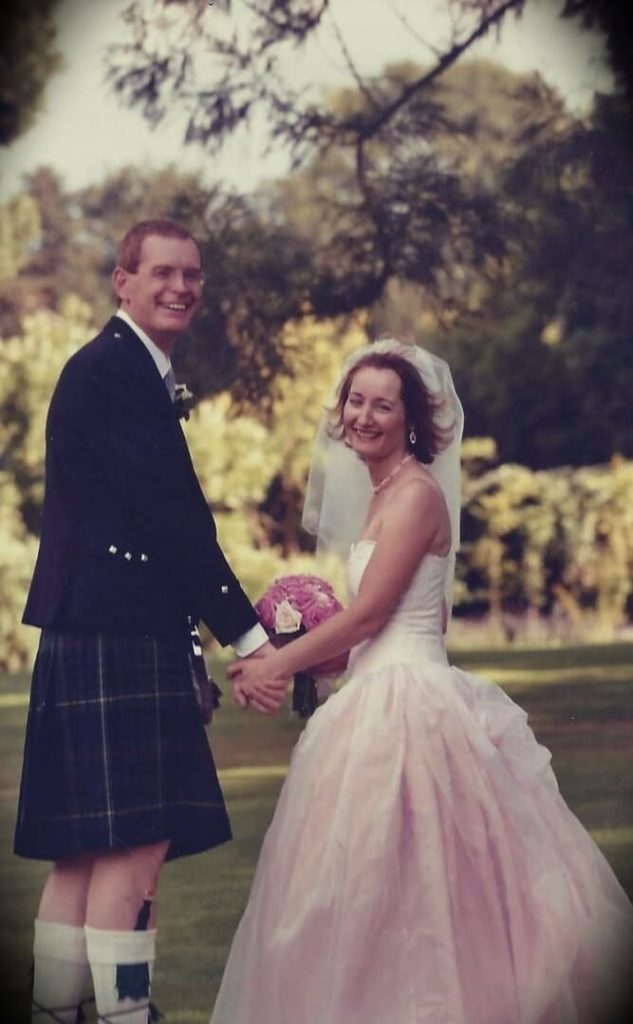 Mark Tilbury with his wife at their wedding