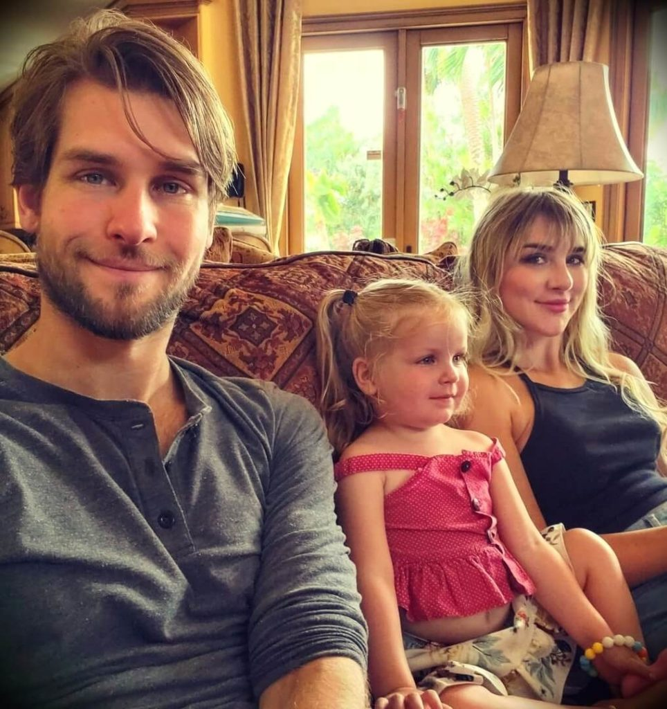 Mikhaila Peterson with her husband Andrey Korikov and their daughter Elizabeth