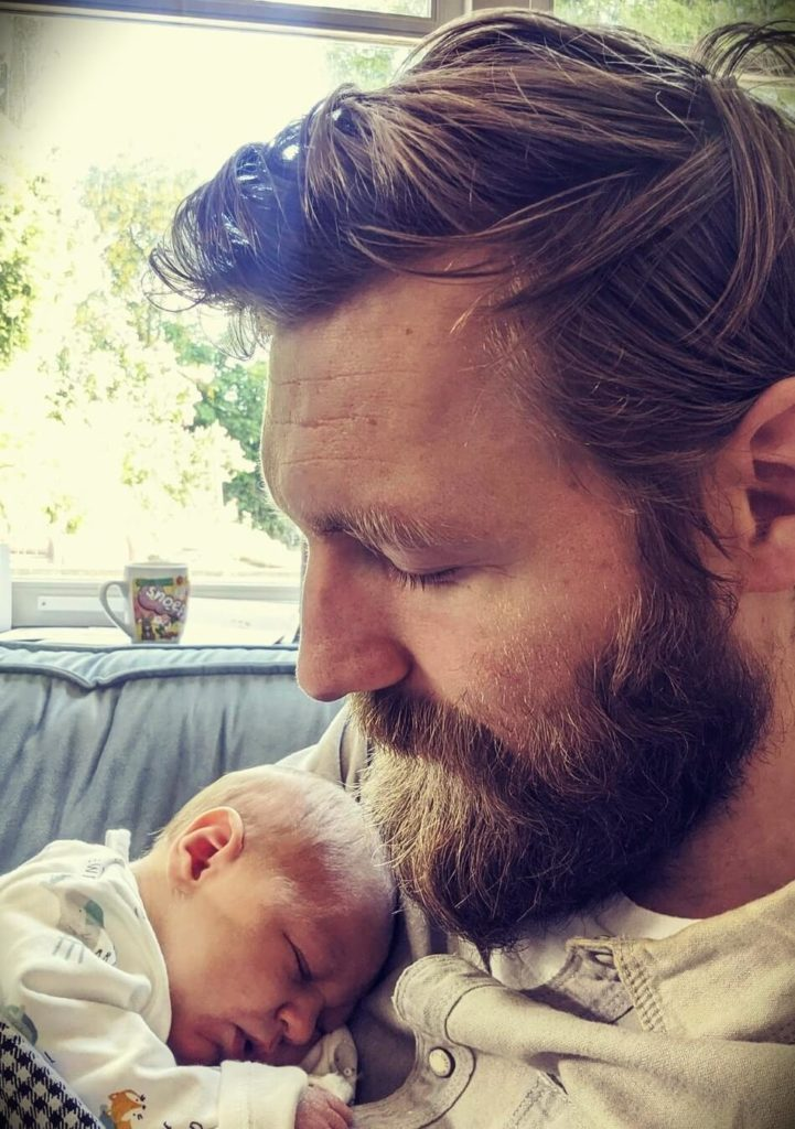 Youtuber and guitarist Paul Davids with his newborn child