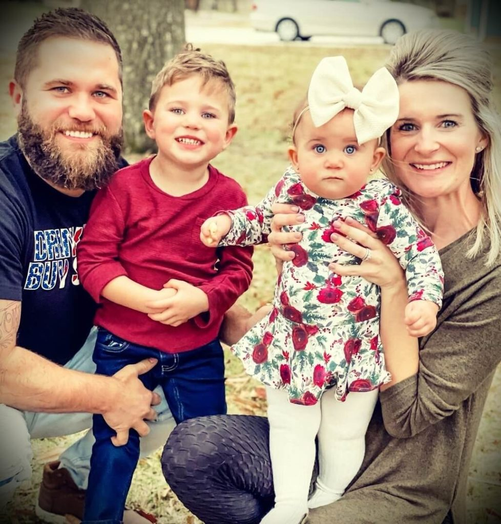 JJ Buckner with his wife Lindsey Buckner and their children