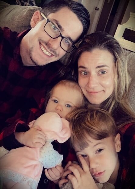 Casey Cooper aka COOP3RDRUMM3R with his wife Hannah Cooper and their children