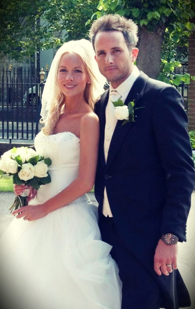 Emily Norris with her husband at their wedding